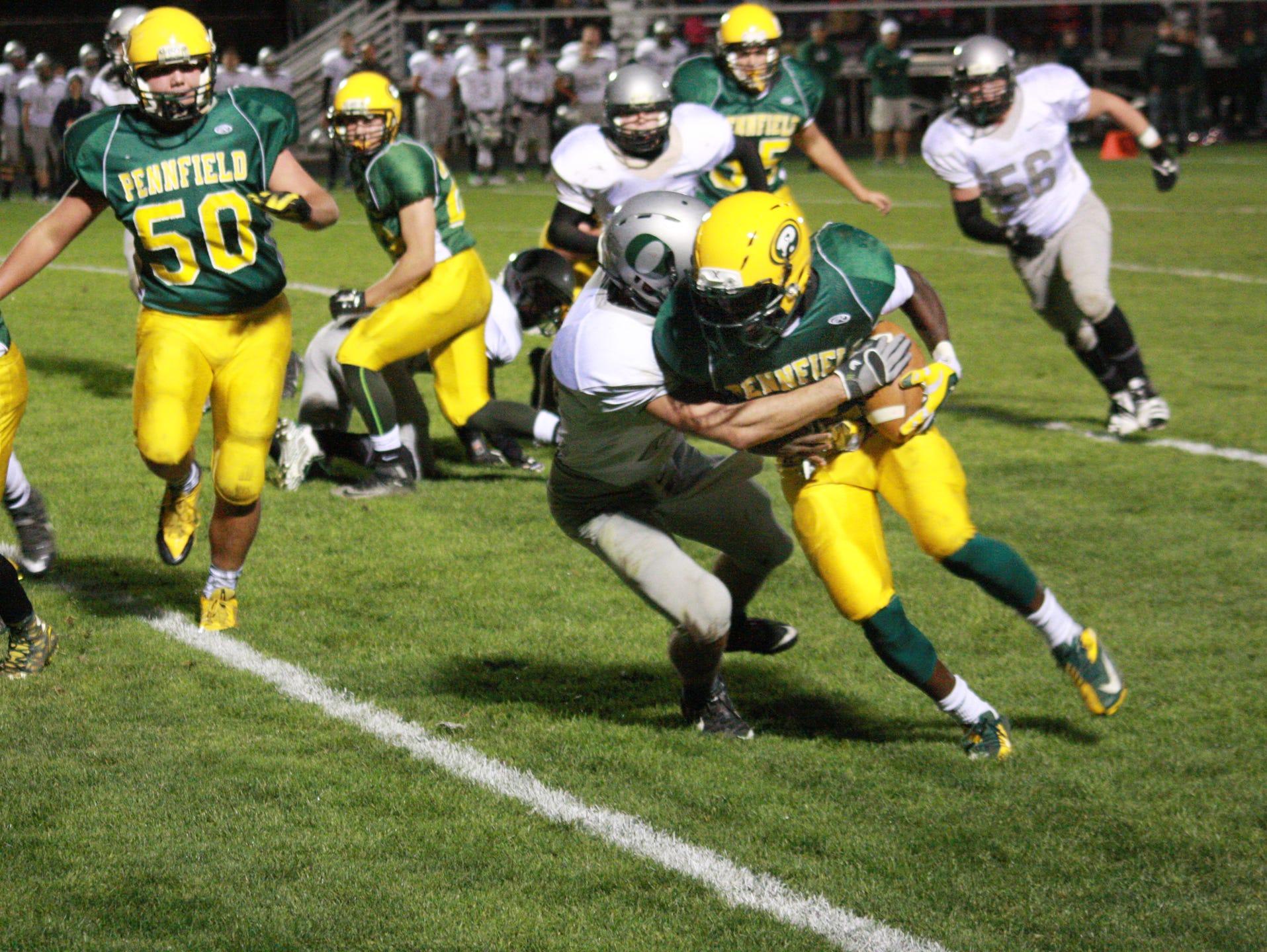 Pennfield High School Quarterback, Parris Bolden gets tackled during Friday night's game against Olivet