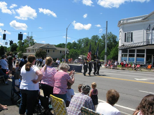 An enthusiastic crowd greeted the marchers at Penfield's Independence Day Parade.