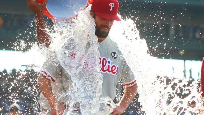 Philadelphia Phillies starting pitcher Cole Hamels is doused with water after throwing a no-hitter against the Chicago Cubs at Wrigley Field on Saturday. The Phillies defeated the Cubs 5-0.