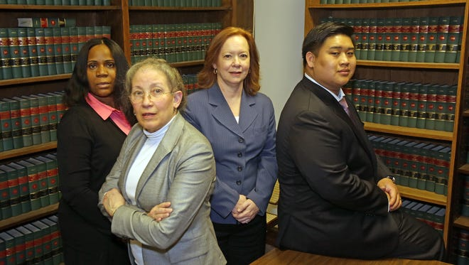 From left, Paralegal Jacqueline Brown with attorneys Hannah Gross, Joanne Stabile, and Nat Sripanya are photographed at the offices of Gross & Stabile in Mount Vernon March 21, 2017.