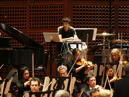 """Mason Bates with the San Francisco Symphony in the world premiere of his work """"The B Sides."""""""