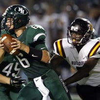 West Allis Hale quarterback Michael Johnson looks for an open receiver while being pursued by West Allis Central''s Josiah Benjamin. Johnson passed for four touchdowns and ran for another in a 41-35 loss to Sussex Hamilton on Sept. 23.