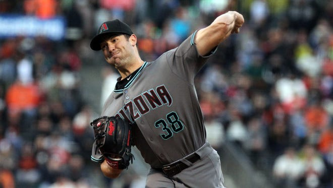 Apr 19, 2016; San Francisco, CA, USA; Arizona Diamondbacks starting pitcher Robbie Ray (38) throws to the San Francisco Giants in the first inning of their MLB baseball game at AT&T Park.