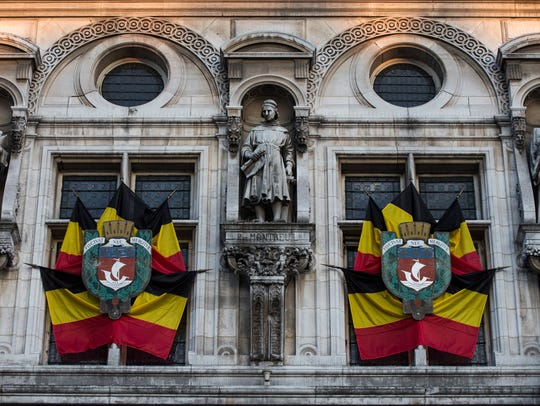 Belgian flags are hung at the front of the Paris City