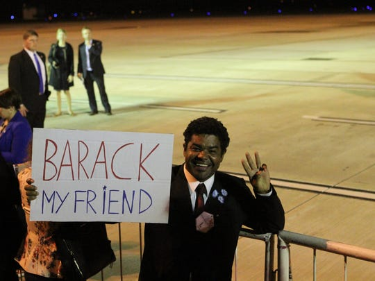 A supporter of U.S. President Barack Obama holds sign