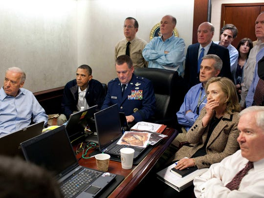 President Barack Obama, Vice President Joe Biden, Secretary of State Hillary Rodham Clinton, along with members of the national security team, receive an update on the mission against Osama bin Laden in the Situation Room of the White House on May 1, 2011.