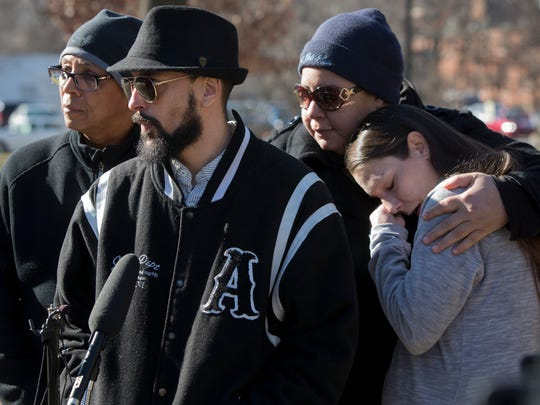 Christopher Hall spoke to the media about his brother, Michael Young. Young was shot and killed by Louisville Metro Police in an abandoned home over the weekend.  On left is community activist Christopher 2X, on right is Young's sister Shawna Coates. Comforting Coates is Nicole Martin, Hall's fiance'. Feb. 13, 2017.