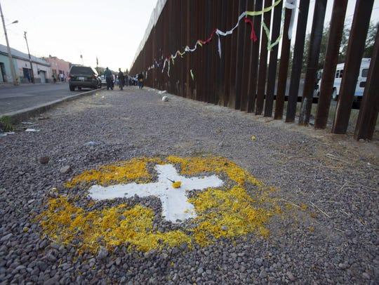 A cross marks the site near where Jose Antonio Elena-Rodriguez