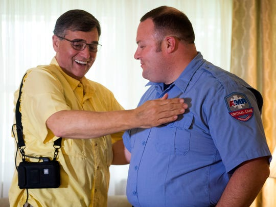 News Sentinel photographer Michael Patrick meets with Andrew Pratt, a critical care paramedic at Dollywood and AMR. Pratt was one of the first responders that help save Patrick's life after he went into cardiac arrest while on assignment at Dollywood.