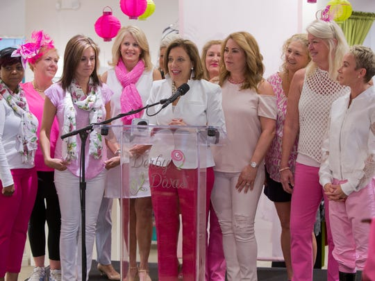 Lynnie Meyer, center, along with other women, announced that jockey's riding in this year's Kentucky Oaks will be wearing pink riding pants to raise funds and bring awareness to breast and ovarian health, through screenings and services. Meyer is the Chief Development Officer for Norton Healthcare. April 20, 2017.