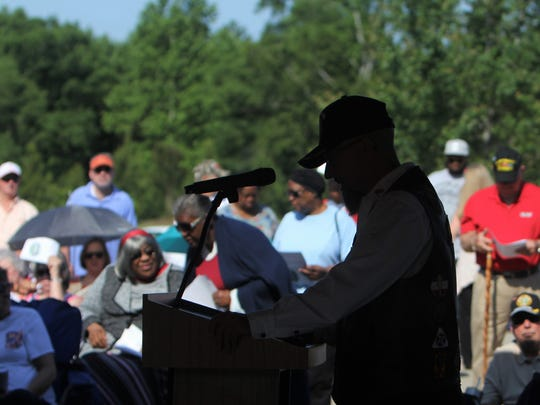 """The names of 383 people who were interred in the past year at the M.J. """"Dolly"""" Cooper Veterans Cemetery were read, one by one, at a ceremony Monday."""