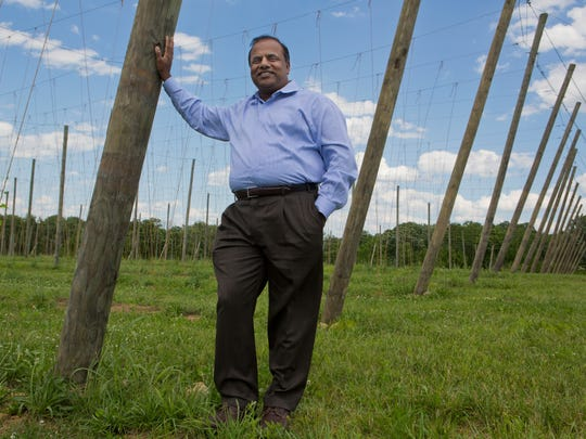 Purna Veer stands next to the structure which will support his hops crop on Veering Creek Farm. Veer is planting hops on the farm to sell to all the local craft brewers in the area. May 30, 2017.