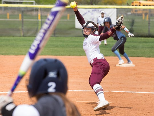 Calallen pitcher Lizette Del Angel throws against Carroll