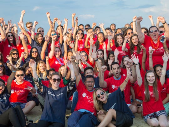 Red and blue came together under a bright sun at the beach as Rutgers Robert Wood Johnson Medical School students wearing red shirts and Monmouth Medical Center residents wearing blue shirts joined together to celebrate the new Rutgers and RWJBarnabas Health partnership at Monmouth Medical Center. Rutgers Robert Wood Johnson Medical School students began rotations in July at Monmouth Medical Center.