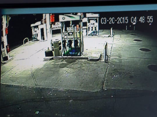 This photo taken from a surveillance camera monitor shows the headlight of a car, on the top right of the screen, traveling the wrong way on Arthur Kill Road in the Staten Island borough of New York on Friday, March 20, 2015, according to gas station manager Ramzi Abdelhaq.