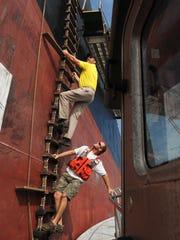 Pilot Matt Sullivan heads up a ladder to the deck of