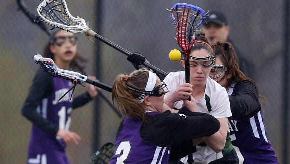 John Jay defeated Brewster 10-9 in girls lacrosse action