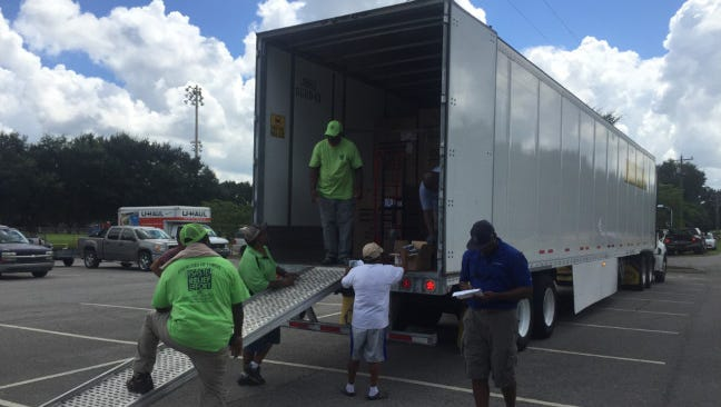The Church of Christ is continuing its big giveaway for flood victims.
