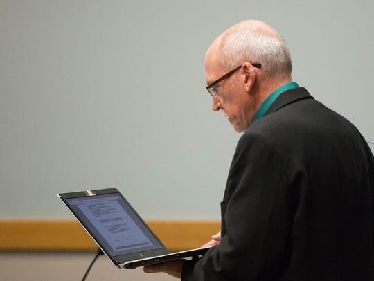 Deputy District Attorney Daniel Sewell reads court