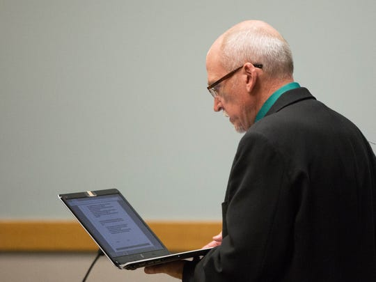Deputy District Attorney Daniel Sewell reads court documents during a hearing for Karsten Cuthair at the 3rd Judicial District Court, Tuesday July 25, 2017.