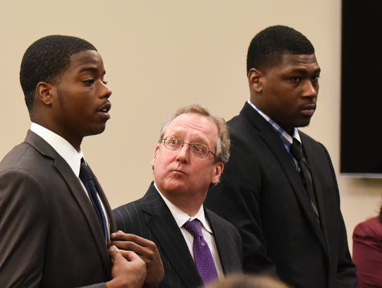 Former MSU football player Donnie Corley, left, addresses Ingham County Circuit Court Judge Rosemarie Aquilina during a sentencing hearing Wednesday, June 6, 2018. Also pictured, from left to right, are his attorney John Shea, former teammate Josh King and attorney Shannon Smith.