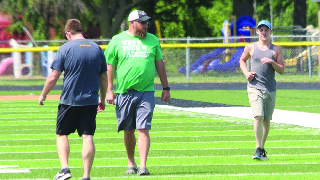 A Macomb athlete participates in a workout from earlier this summer when the state of Illinois was in Phase 1 of the Restore Illinois Guidelines.