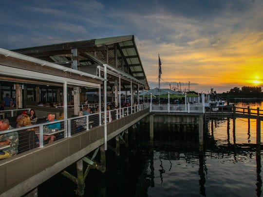The outdoor dining space at Jack Baker's Wharfside Restaurant in Point Pleasant Beach overlooks the Manasquan River.