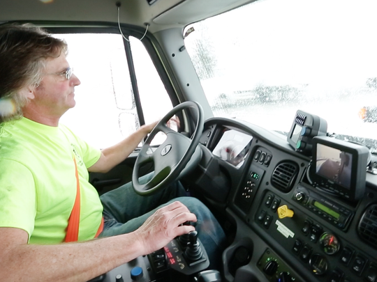Snow plower Scott Van Price plows roads during the