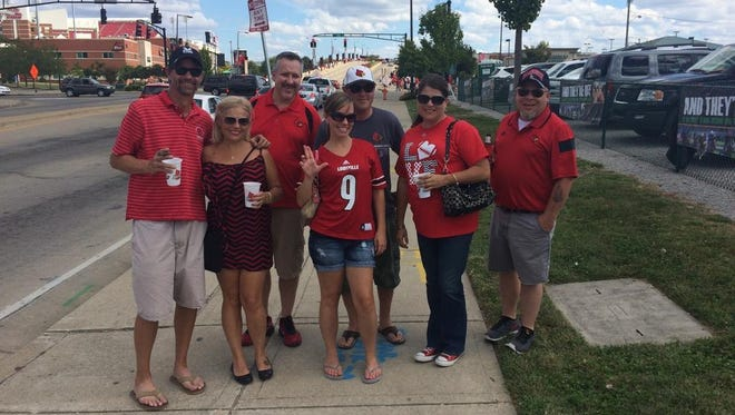 """Stephanie Garner, center, won our game-day style contest in the """"most extreme"""" category."""