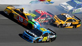 Kyle Busch (18),  Erik Jones (77) and Matt Kenseth (20) wreck with a few laps remaining at the end of the second segment. All three Toyota drivers were knocked out of the race with damage.