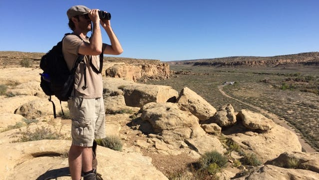 Artist in residence John Vokoun examines a distant landscape at Chaco Culture National Historic Park.