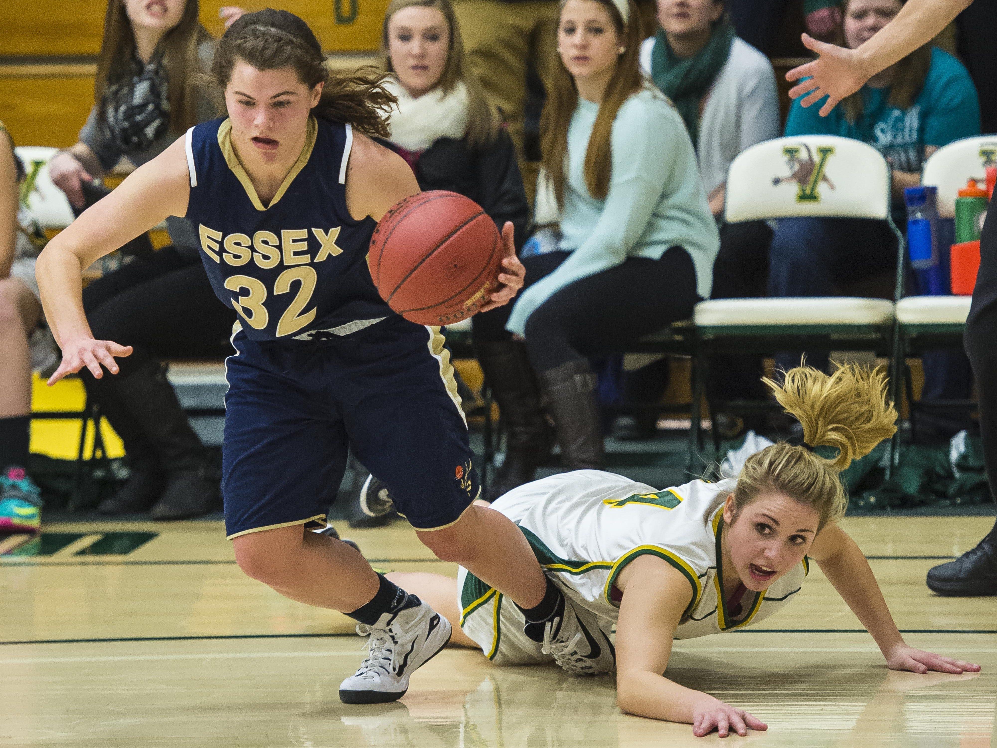 Essex's Mychaela Harton (left) evades pressure from BFA's Jillian Berno during the Division I high school girls basketball semifinals last year.