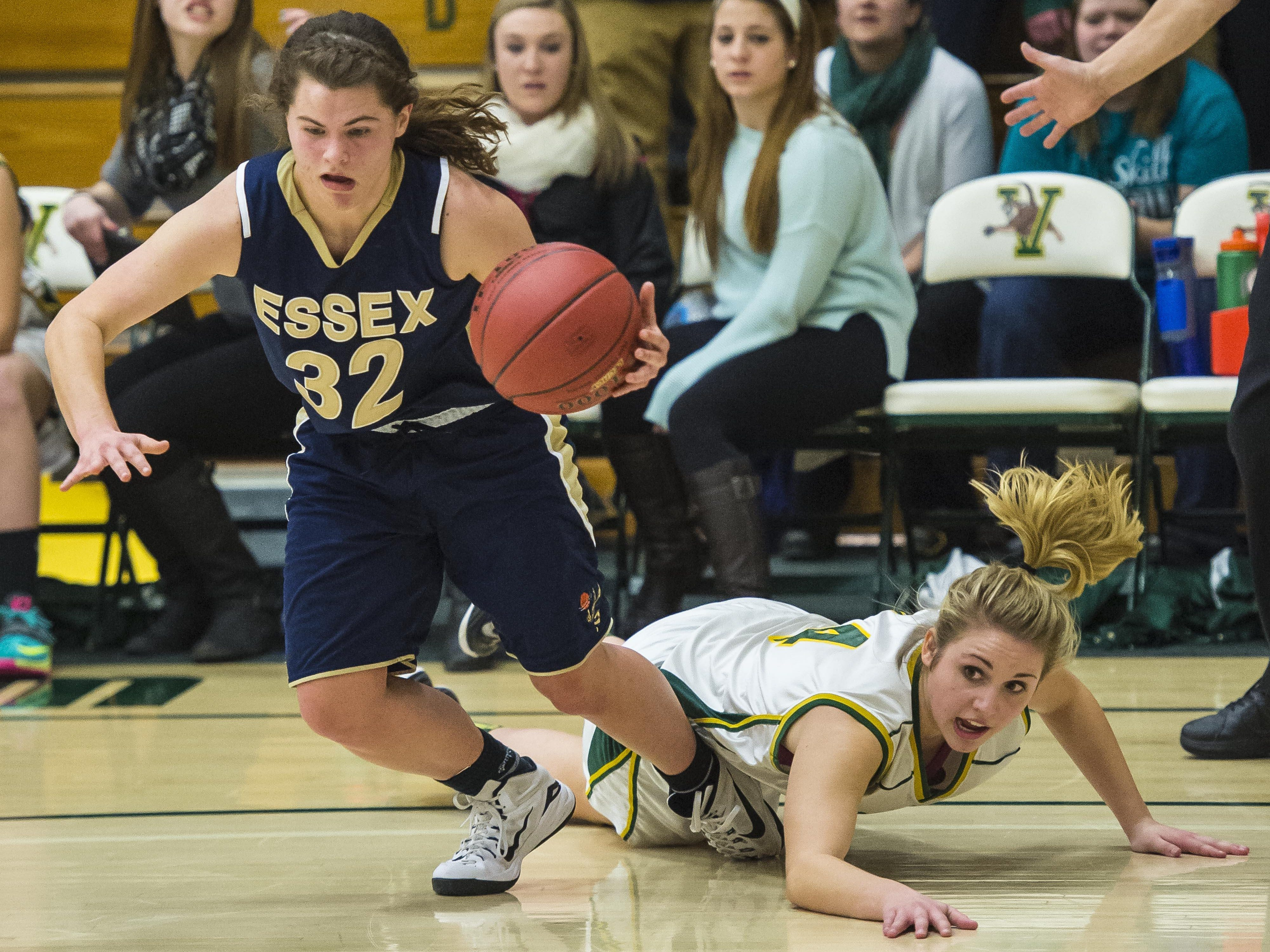 Essex's Mychaela Harton (left) evades pressure from BFA's Jillian Berno during the Division I high school girls basketball semifinals last year.