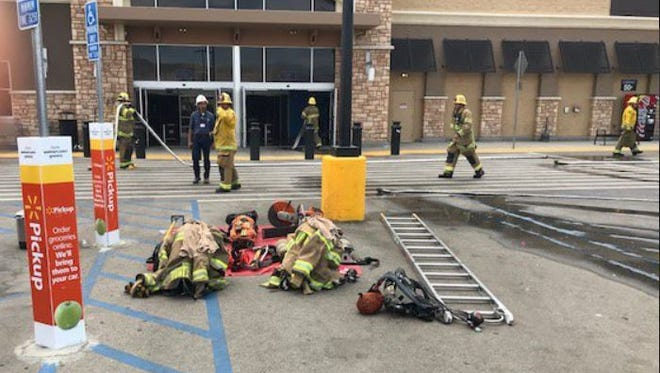 Firefighters responded to a fire at a Walmart in Indio Tuesday. Three people were injured.