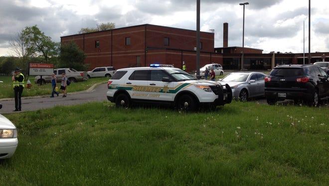 Sheriff's deputies remain on the scene at Krisle Elementary at 3:40 p.m.