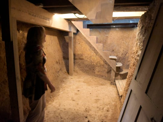 "Carol Kauffman, Community Outreach Director of the Crispus Attucks Association, shows the hidden room used in the Underground Railroad at the Goodridge House Tuesday, Feb. 23, 2016. The center will open for the first time for a ""sneak peek"" at 1 p.m. Saturday, May 21, to celebrate Crispus Attucks 85th anniversary. Bill Kalina photo"