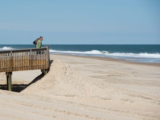 Dorian Corrigan and his wife Lori of Millsboro stand and look at the ocean at Bethany Beach.