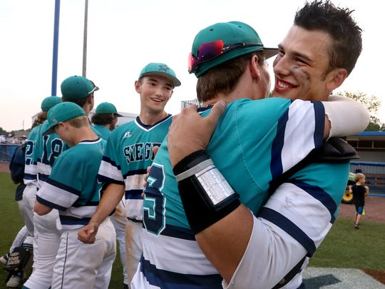 Siegel's seniors Tyler Kirkland (9) and Alex Carignan(13) embrase as they celebrate winning the 2016 TSSAA Class AAA State Baseball Championship over Arlington, on Friday, May 27, 2016. The pitcher for the 7th inning Jacob Key (5), who stuck out all three batters watches in the background.