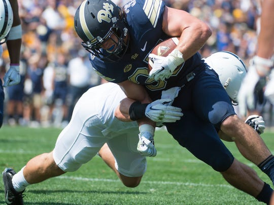 Penn State Nittany Lions linebacker Jake Cooper (33) is unable to keep Pittsburgh Panthers fullback George Aston (35) out of the end zone at  Heinz Field in Pittsburgh as Penn State fell to Pitt 42-39 on Saturday, Sept. 10, 2016.