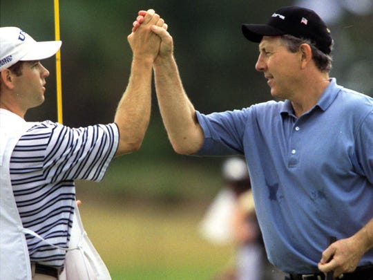 Winner Hale Irwin, right, and his caddie, Kenny Harms, share a moment Sunday after Irwin won The ACE Group Classic at The Club at TwinEagles on Feb. 11, 2002. Irwin entered the final round of the tournament in second place behind Tom Watson.
