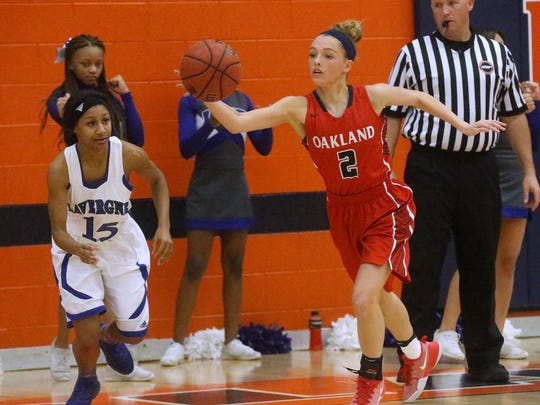 Oakland's Faith Adams (2) steals the ball away from