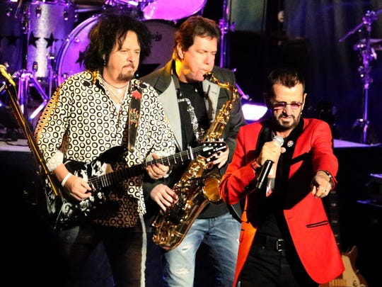 Ringo Starr, right, with guitarist Steve Lukanther and saxophonist Warren Ham Monday night.