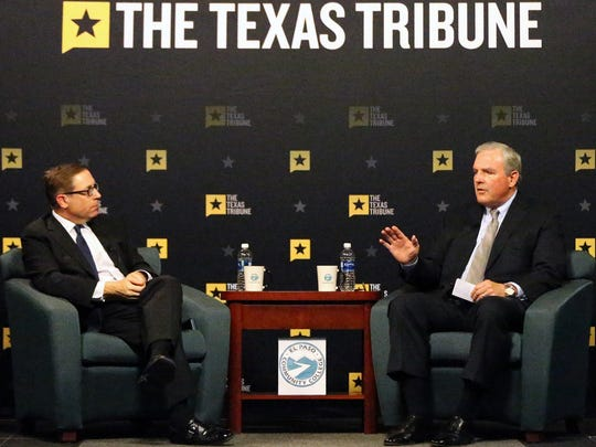 El Paso Mayor Dee Margo, right, answers questions from