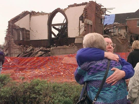 Meg Evans, right, hugs Mary Lloyd Pearson after they saw the damage done to St. Ann's Episcopal Church in Nashville on April 19, 1998. The church, built in 1882, suffered extensive damage when it was hit by a tornado on April 16.