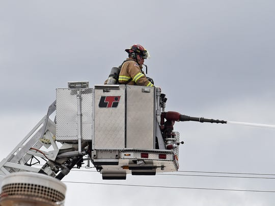 Sparks firefighters work to extinguish a fire at an