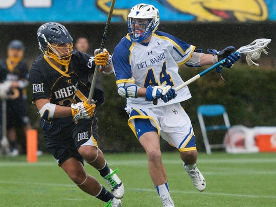 Delaware's Brian Kormondy, right, looks for room to shoot around Drexel's Markel Nelson, left, in the first quarter of a conference lacrosse game at Delaware Stadium on Saturday afternoon, March 29, 2014. Delaware lost to Drexel by a score of 9-7.