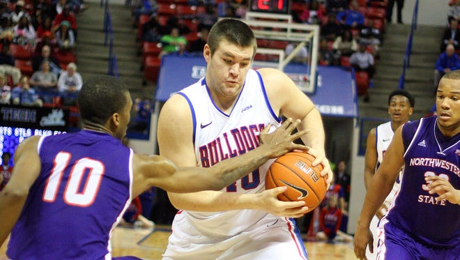 Former Louisiana Tech center Gibby Talbot (40, with ball) is transferring to LSU of Alexandria to play for the Generals. The 6-foot-10 native of Houma brings much-needed size to coach Larry Cordaro's roster.