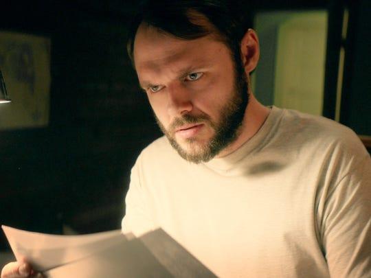 "Christopher Denham in a scene from ""Camera Obscura."""