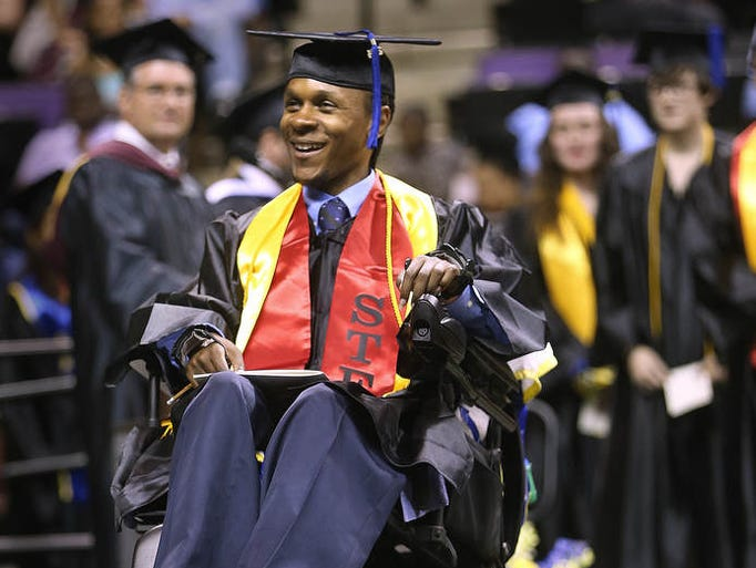 TCC graduate Eddie Gibson makes his way across the civic center stage to receive his degree on Saturday. 400 TCC students took their walk during their Spring Graduation ceremony inside the civic center on Saturday night, May 3, 2014. Judge Nikki Clarke gave the commencement address.