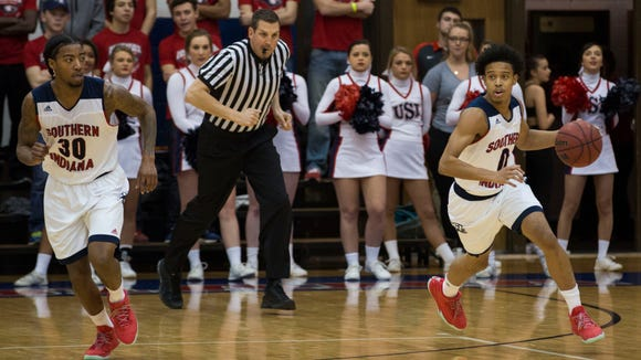 USI's Marcellous Washington (0) brings the ball up after Lees-McRae gave it up during Sunday night's game.